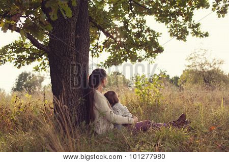 Mother And Toddler Girl Have Rest Outdoors