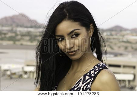 Beautiful exotic young woman with long straight hair