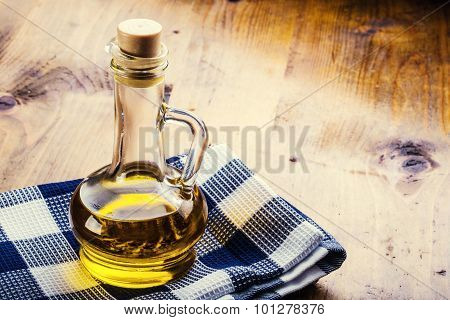Carafe - Bottles of olive oil blue checkered cloth on a wooden table