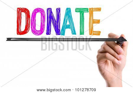 Hand with marker writing the word Donate