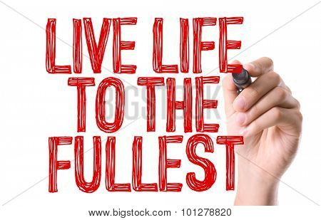Hand with marker writing the text Live Life To The Fullest