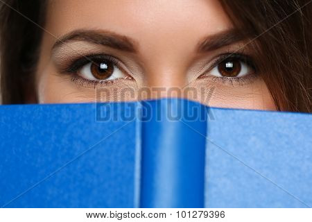 Beautiful Brunette Woman Covering Face