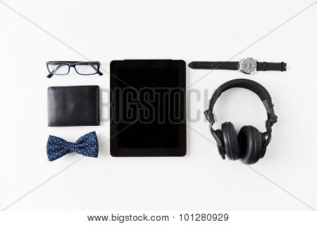 hipster personal stuff and objects concept - tablet pc computer, earphones, wallet, eyeglasses and wristwatch on table