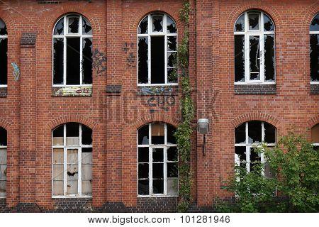 derelict facade with broken windows