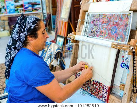 Side, Turkey - May 24, 2015: An Unidentified  Woman Weaves A Carpet By Hand