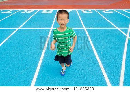 Boy Running On Racetrack