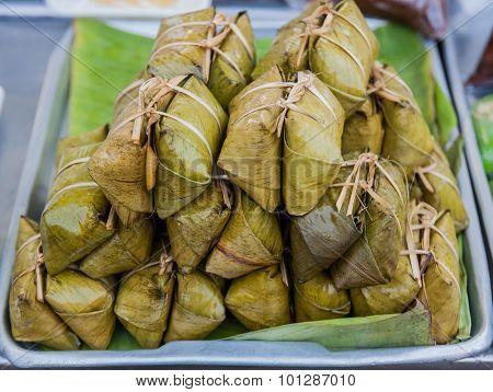 Bunch Of Mush ,thai Dessert Style Which Insert Banana Inside To Glutinous Rice.