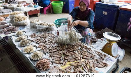 Woman Sell Dried Fish In The Local Market