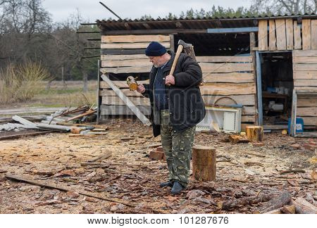 Old Ukrainian peasant with an axe