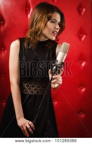 Female Singer With Microphone