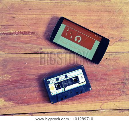 Concept Of Difference Technology ,picture Of Smart Phone Playing Online Radio And Old Cassette Tape