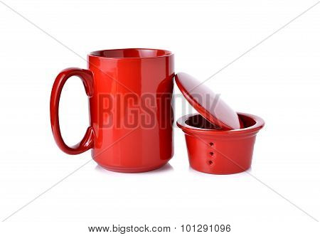 Red Tea Cup With Filter And Lid On White Background