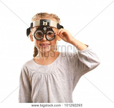 Young girl undergoing eye test with Spectacles isolated on white