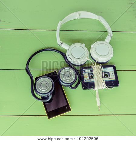 New Smartphone Cassette Tape And Headphone On The Wood Board