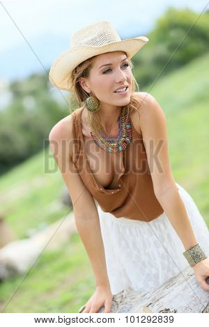 Attractive woman; model with cowgirl style