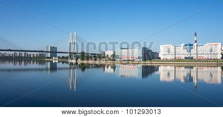 reflections on the Neva river of bridge and skyline