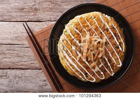 Japanese Okonomiyaki On A Wooden Table. Horizontal Top View
