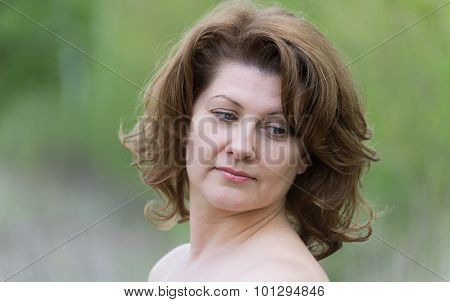 Middle-aged Woman In The Summer Park