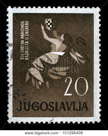 YUGOSLAVIA - CIRCA 1960: A stamp printed in Yugoslavia dedicated to 100 anniversary of the Croatian National Theatre in Zagreb, circa 1960.