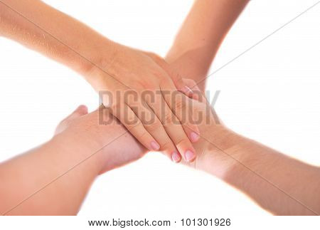 Four Girl Friends Holding Hands In A Pile Of Unity And Teamwork
