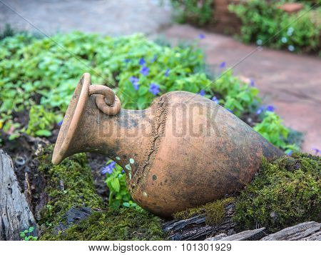 Beautiful And Old Pottery Pitcher Decor In The Mini Garden
