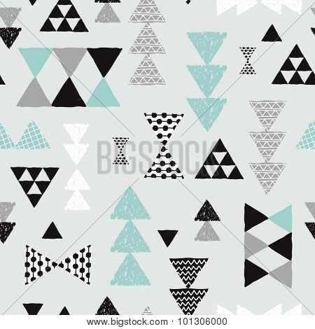 Seamless geometric mint pastel blue black and white tribal triangle arrow hand drawn pastel background pattern in vector