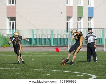 RUSSIA TROITSK CITY - JULY 11: Sergey Kalashnikov (8) on free shot during Russian american football Championship game Spartans vs Raiders 52 on July 11 2015 in Moscow region Troitsk city Russia