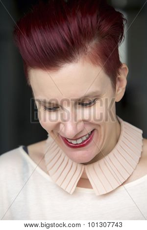 Portrait Of Red-haired Woman Smiling