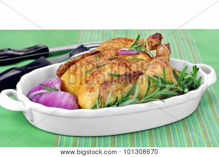 Roast Chicken With Fresh Rosemary And Red Onions.