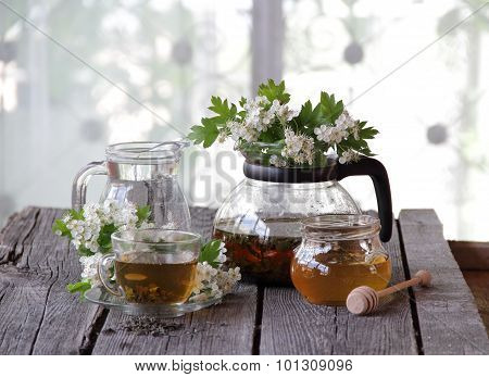 Green Tea In A Glass Cup, Honey And A Branch Of A Blossoming Hawthorn