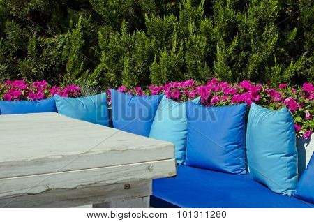 Resting place with blue pillows in the garden