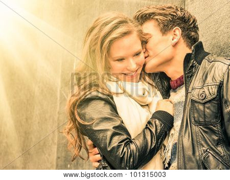 Couple At The Beginning Of A Romantic Love Story - Fashion Man Whispers A Kiss In Woman Ear