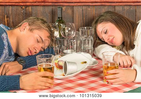 Couple Sleeping After A Huge Alcoholic Dinner