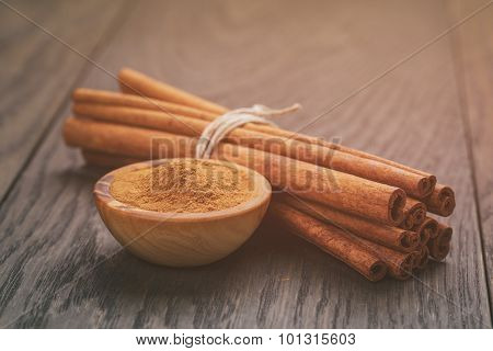bunch of cinnamon sticks tied with twine, on rustic table