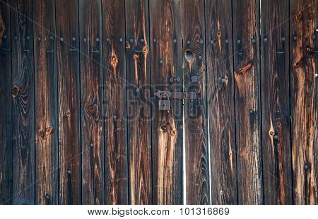 Old, Rusty Padlock On The Wooden Hangar Doors