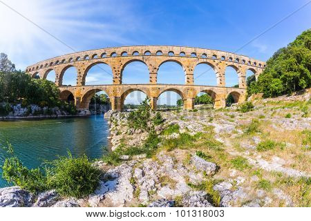 Provence, spring sunny day. Three-tiered aqueduct Pont du Gard - the highest in Europe. The bridge was built in Roman times on the river Gardon