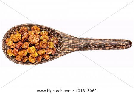 dried goldenberries on a wooden spoon isolated on white - superfruit