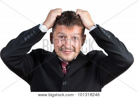 Businessman tearing his hair