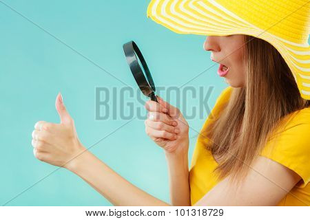 Girl Holding Magnifying Glass Looking On Fingernails