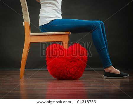 Woman Legs With Red Heart Pillow On Floor