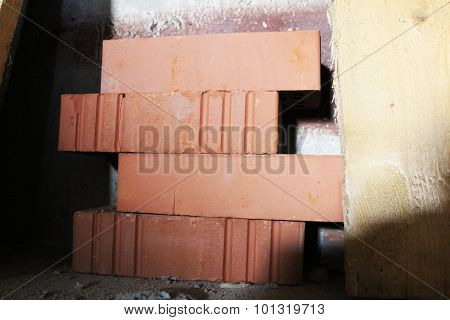 Four New Brick In Warehouse - Side View