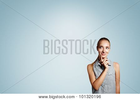Portrait Of Handsome Young Thoughtful Blonde Woman Isolated Over Blue Background