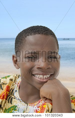 Lovely boy smiling at the beach, ten years old