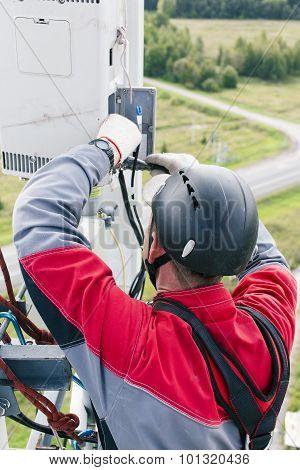 maintenance engineer repairing telecommunications equipment