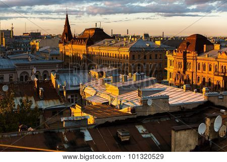 Top view over the roofs of the old center of St. Petersburg during an beautiful sunset.