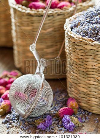 Lavender, Roses Herbal Tea In Basket And tea infuser. Selective Focus.