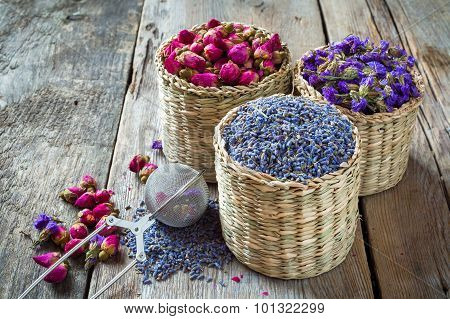 Herbal Tea Assortment: Lavender, Roses And Chinese Forget-me-not In Wicker Basket. Selective Focus.