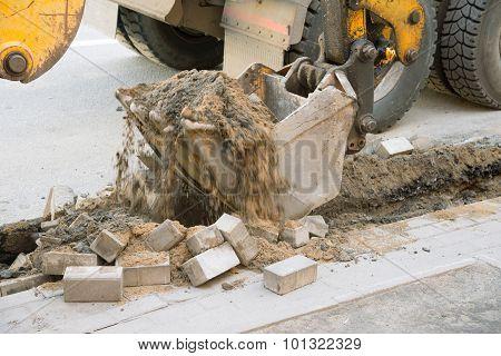 excavator on the street asphalt road repair