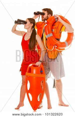 Lifeguards With Rescue Ring Buoy And Life Vest.