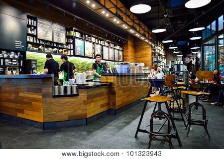 BANGKOK, THAILAND - JUNE 21, 2015: Starbucks Cafe interior. Starbucks Corporation is an American global coffee company and coffeehouse chain based in Seattle, Washington